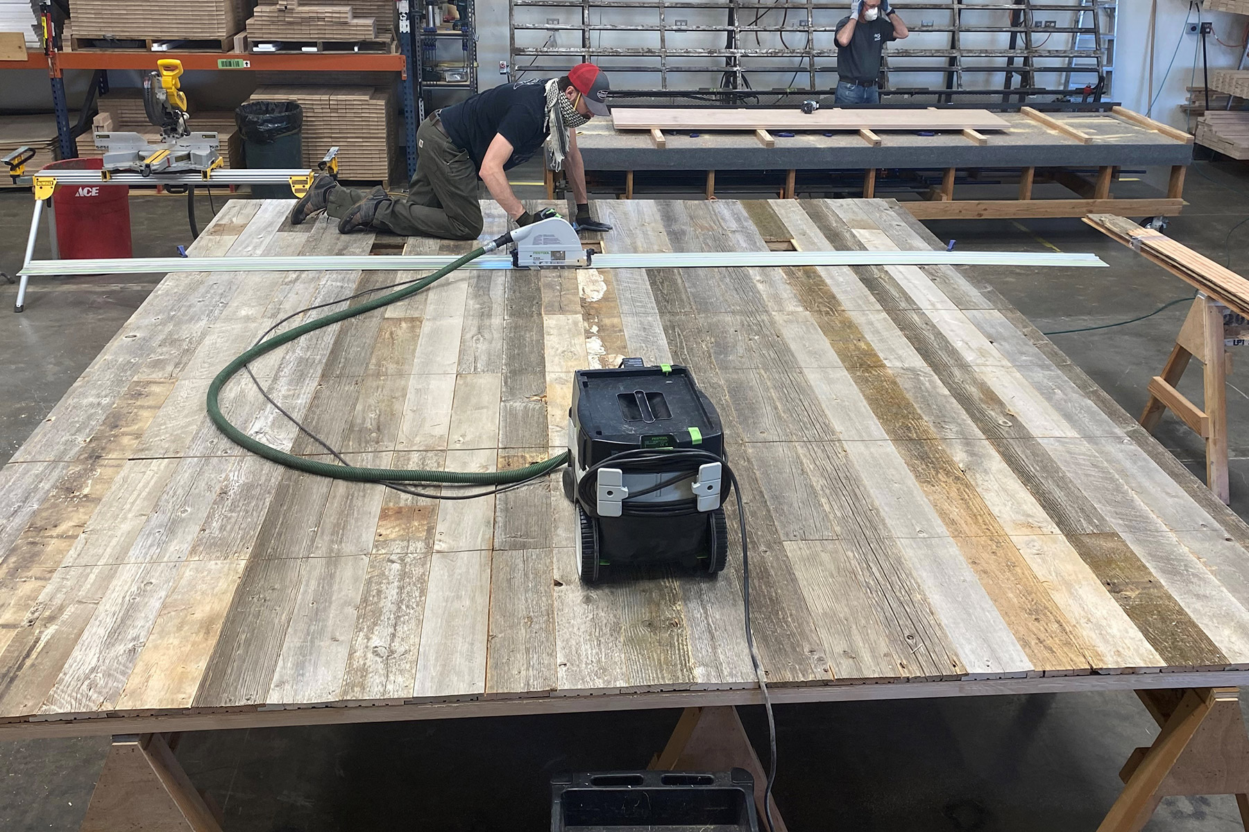 Custom barn wood garage door being sanded