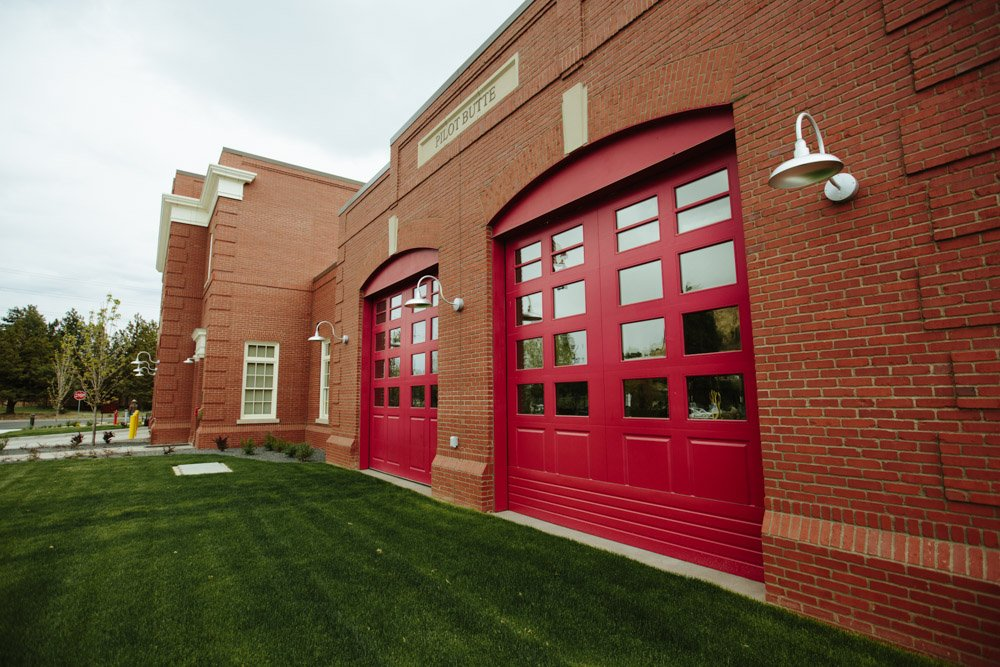 Pilot Butte Fire Station and red carriage garage doors
