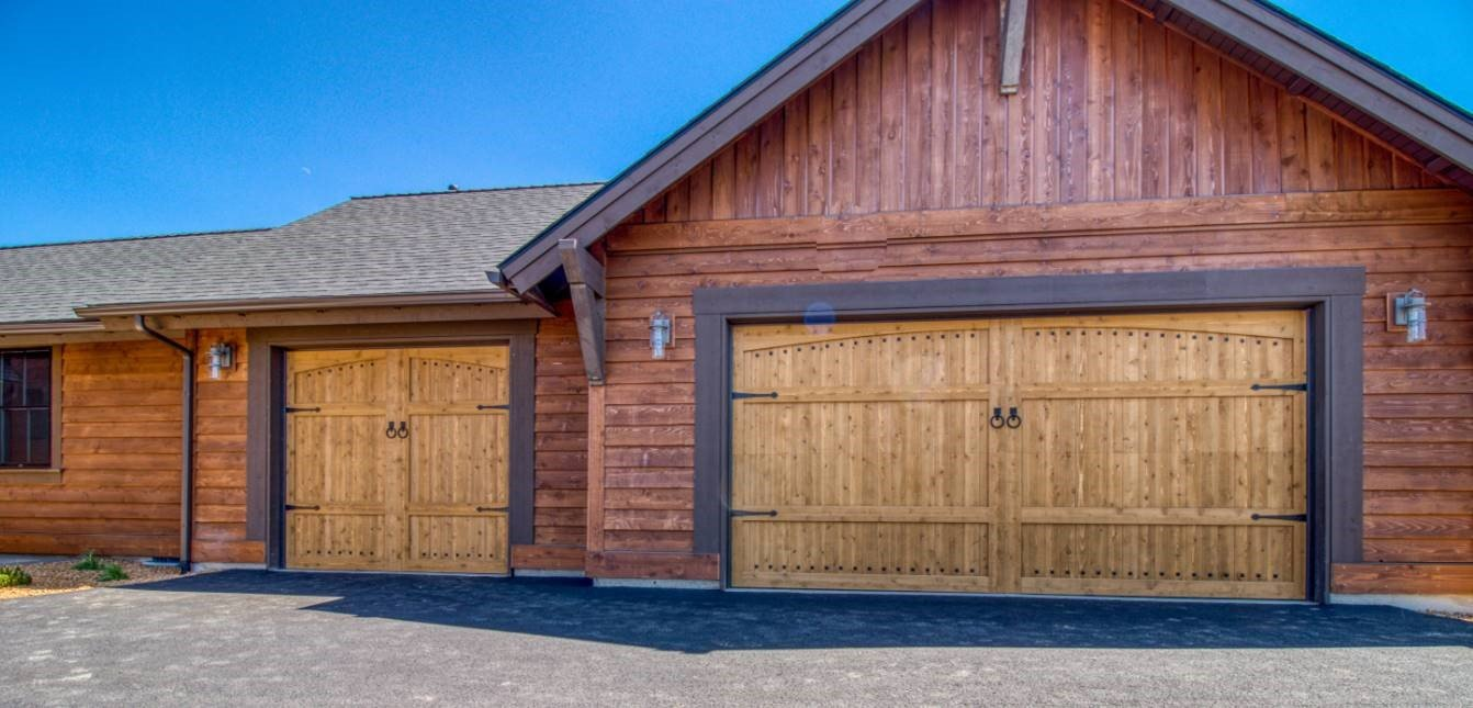 Custom wood garage door with vertical windows